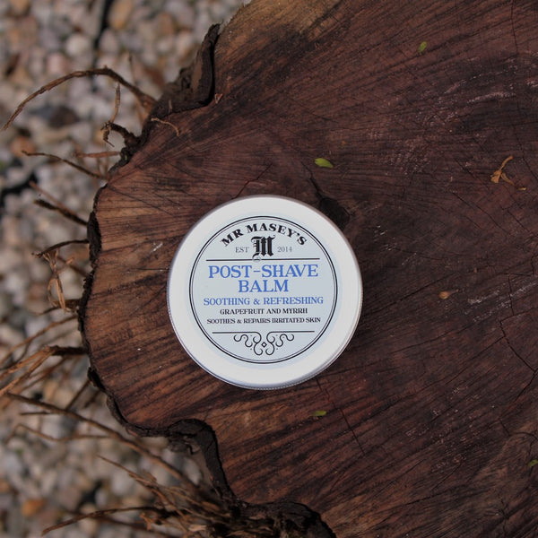 Post shave balm tin on a log
