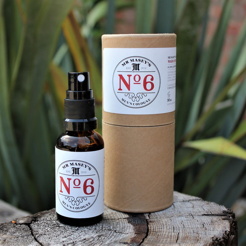Mr Masey's Handmade Vegan No.6 Cologne bottle and box on a tree stump