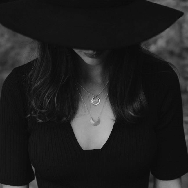 Emily Eliza Arlotte Handcrafted Fine Jewellery - Luna Crescens Necklace Moon Crescent Sterling Silver Gold Handmade Boho Feminine Dainty Fashion Witchy Style Girl Wearing Wide Brim Hat