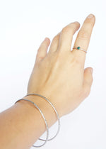 Emily Eliza Arlotte Handcrafted Fine Jewellery - Sterling Silver Opal Dainty Galaxy Ring Worn Hand on white background Bangles Textured