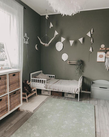 Colorful nursery with green play mat