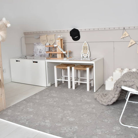 Playroom with large play mat in grey color