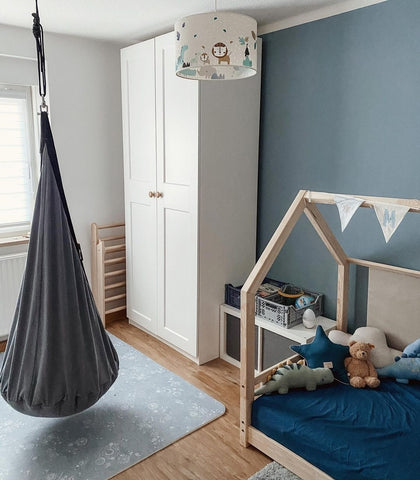 Colorful nursery with blue wall and play mat