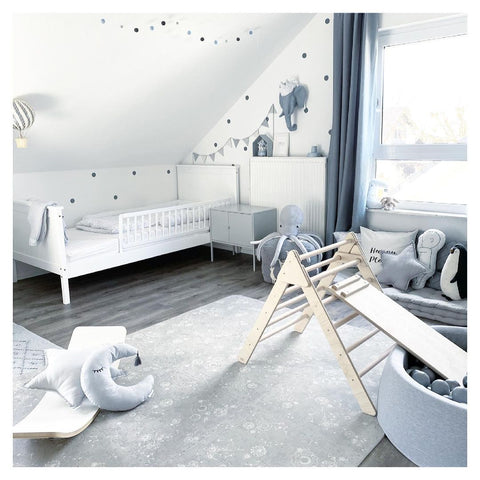 Nursery with large play mat in grey tones