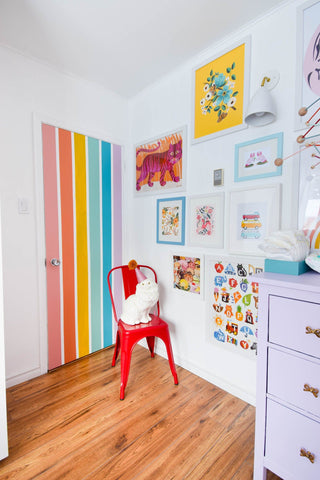 Colorful nursery with a door painted in stripes like a rainbow