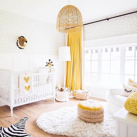 Bright nursery with pops of yellow in the objects such as in the curtains