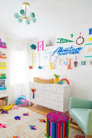 Colorful nursery with gallery wall