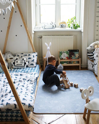 Colorful nursery with a blue Play Mat
