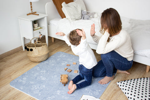 Busy moms spring cleaning with children
