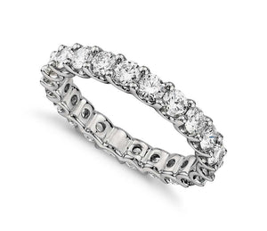 Round Brilliant Large Claw Set Eternity Band