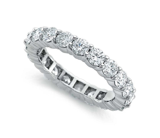 Round Brilliant Claw Set Eternity Band