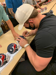 JJ Watt signing Houston Texans mini helmets