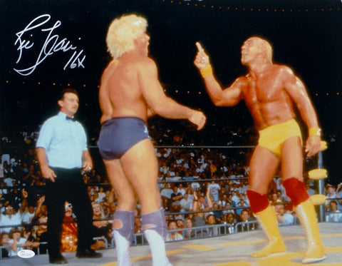 Ric Flair Autographed 16x20 Against Hulk Hogan Photo- JSA Witnessed Auth