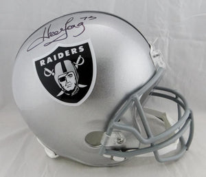 Howie Long Autographed F/S Oakland Raiders Helmet- JSA Witnessed Auth *Black