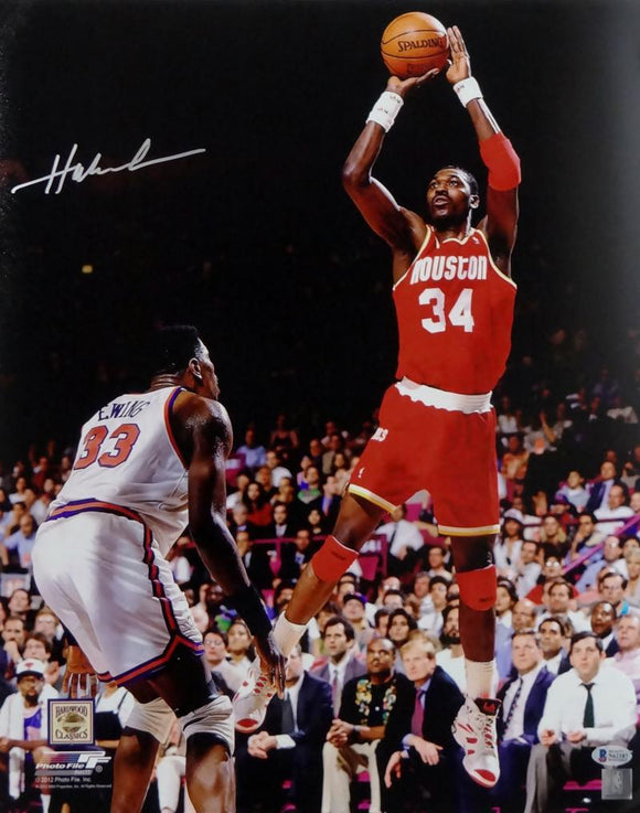 Hakeem Olajuwon Houston Autographed 16x20 Jump Shot vs Ewing Photo- Beckett Auth *Silver
