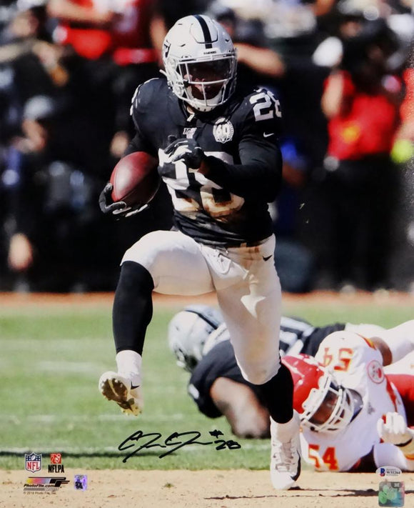 Josh Jacobs Autographed Oakland Raiders 16x20 Running PF Photo- Beckett Auth *Black