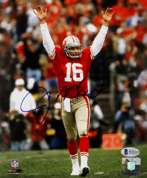 Joe Montana Autographed San Francisco 49ers 8x10 PF Arms Raised Red Jersey Photo- Beckett Auth *Blue