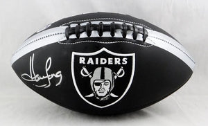Howie Long Autographed Oakland Raiders Black Logo Football- Beckett Auth *Silver