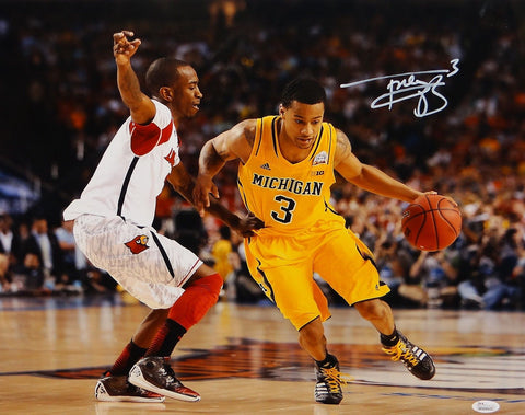 Trey Burke Autographed 16x20 Dribbling Photo-JSA W Authenticated