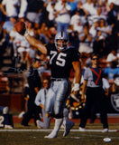Howie Long Autographed Raiders 16x20 Holding Ball Photo- JSA Witnessed Auth