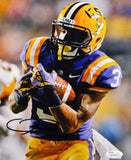 Odell Beckham Autographed 8x10 LSU Cradling Ball Photo- JSA Authenticated