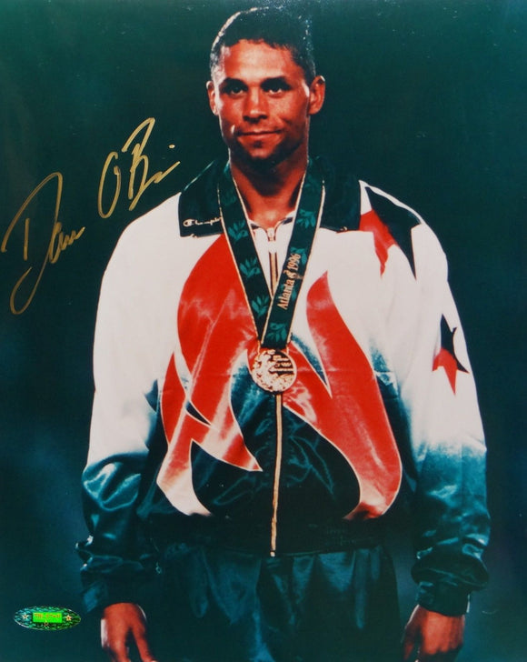Dan O'Brien Autographed 8x10 With Medal Photo- TriStar Authenticated