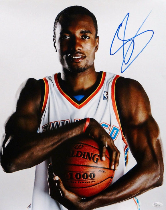 Serge Ibaka Autographed 16x20 Holding Basketball Photo- JSA Authenticated