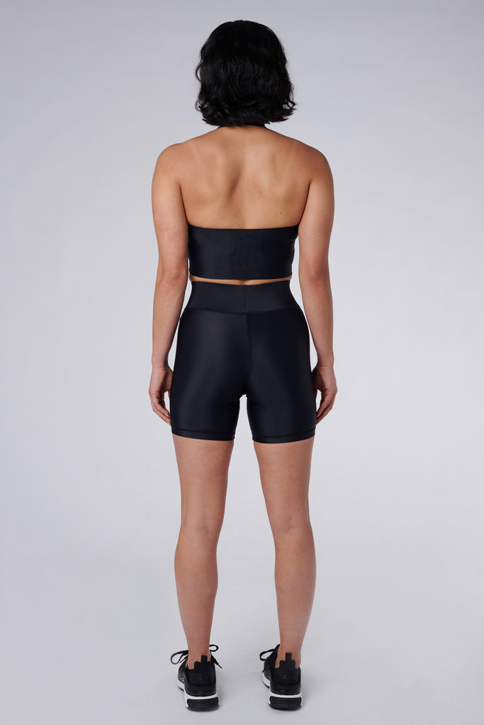 Back view of model wearing Cora Bicycle Shorts in Black