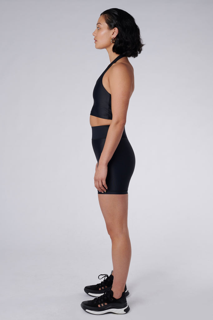 Side view of model wearing Cora Bicycle Shorts in Black