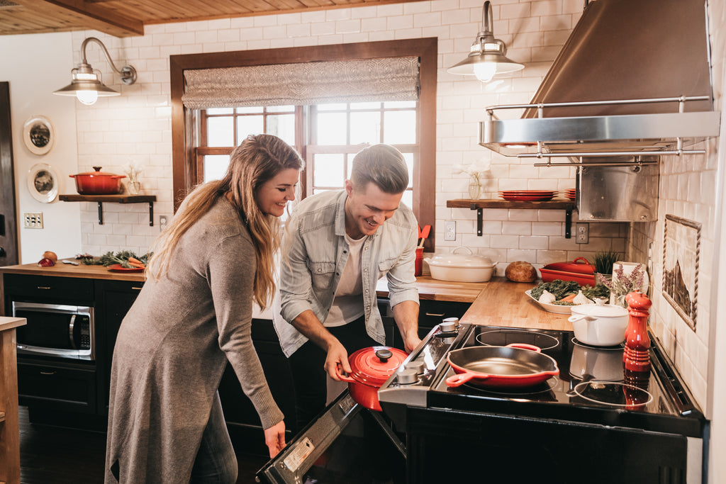 Couple using a oven