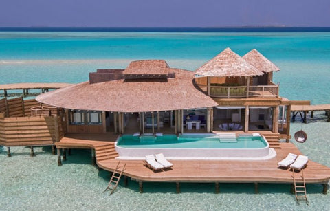 house on top of the beach in the maldives