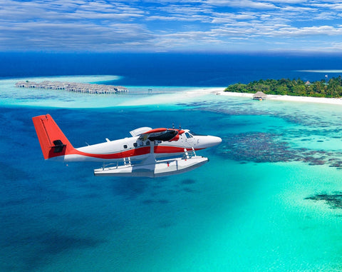 Plane flying over the maldives
