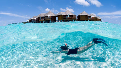 snorkeling in a resort in the maldives