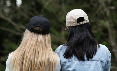 What's the difference between the two new Rise + Dew hat styles?
