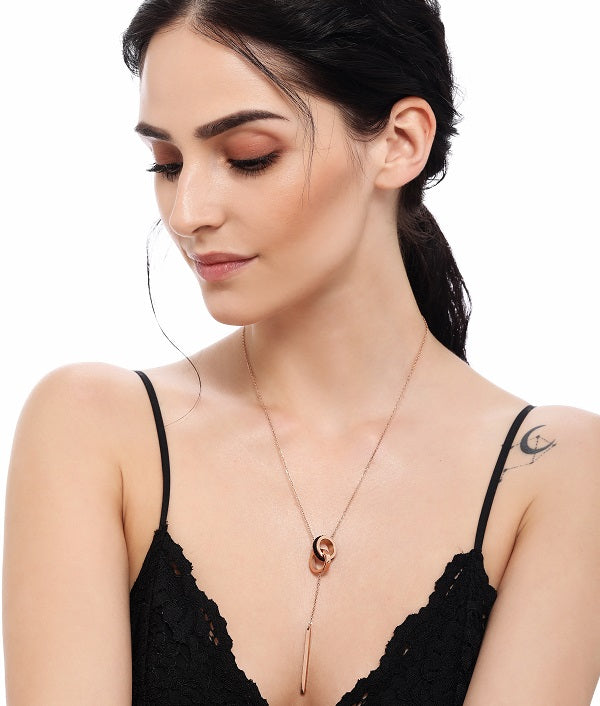 Forever Necklace by FSAHKA in Rose Gold & Black, adorned by a model