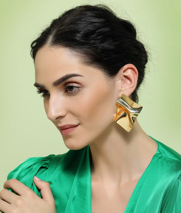 Gold Surface Earrings by Fashka | Side view