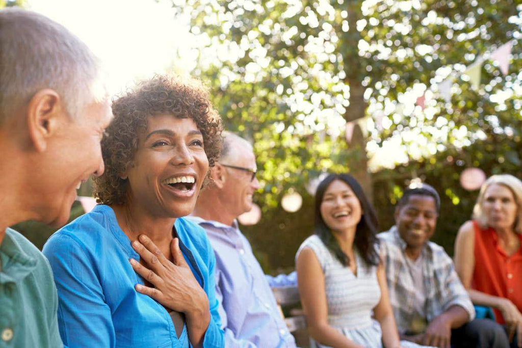 Group Of Mature Friends Socializing In Backyard Together | Calcium To Magnesium: How The Ratio Affects Your Health | calcium magnesium relationship