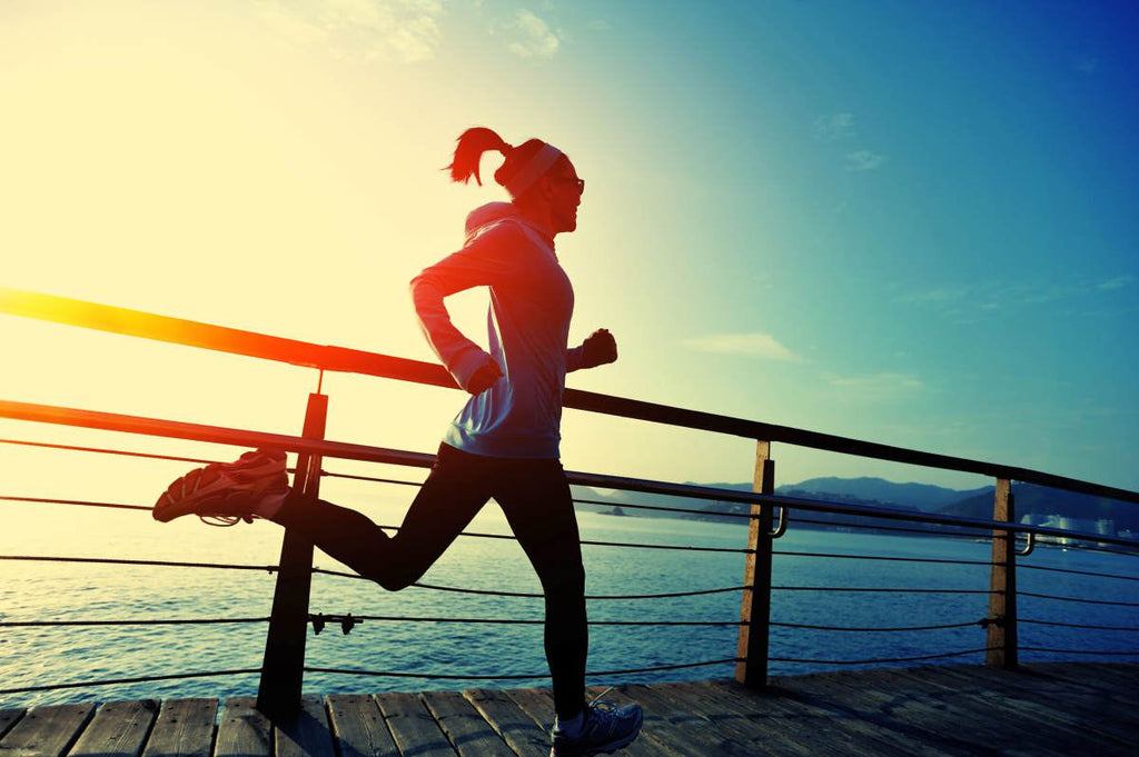Healthy lifestyle sports woman running on wooden boardwalk sunrise seaside | Is ALA The New Silver Bullet Of Weight Loss? | alpha lipoic acid benefits weight loss