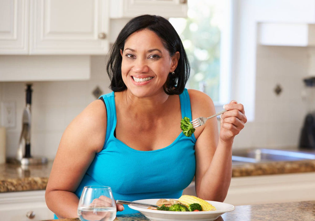 Overweight Woman Eating Healthy Meal in Kitchen | Is ALA The New Silver Bullet Of Weight Loss? | does alpha lipoic acid help with weight loss
