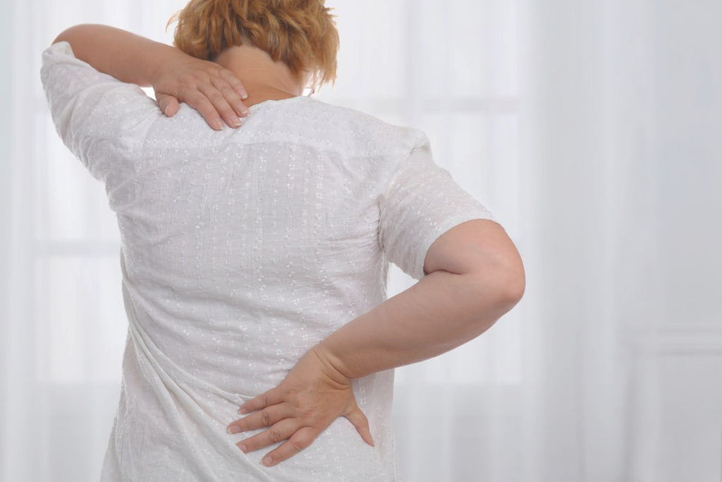 Woman suffering from back and neck pain | Metabolic Balance For Maximum Health | metabolic imbalance | metabolic imbalance symptoms