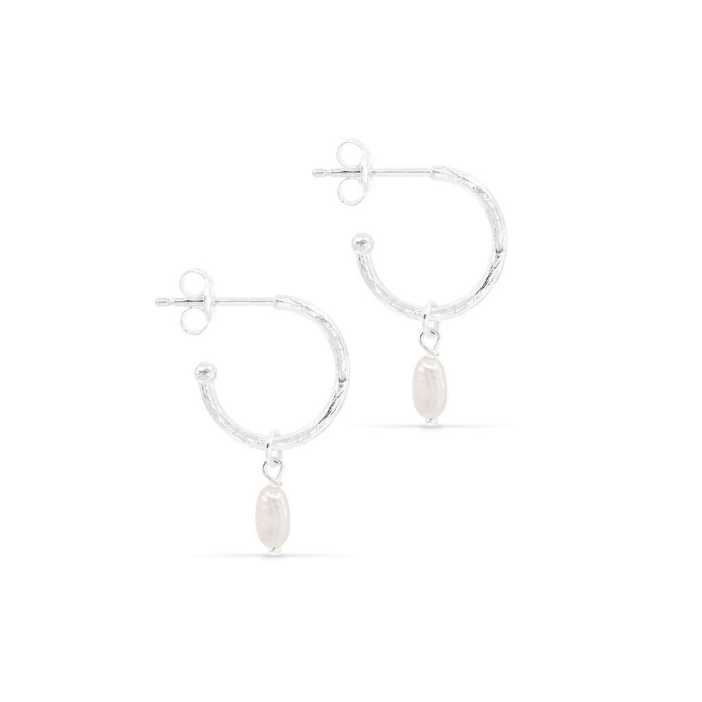 By Charlotte Eternal Peace Hoop Earrings in silver online at PAYA Boutique - Free delivery to Australia