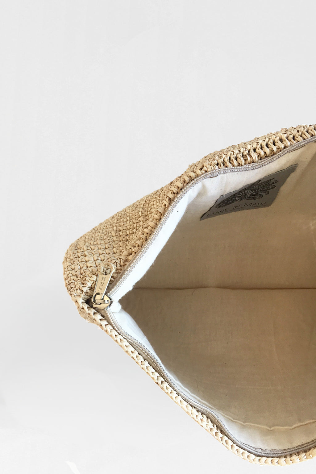 Buy Gisele Clutch from MADE IN MADA at paya boutique