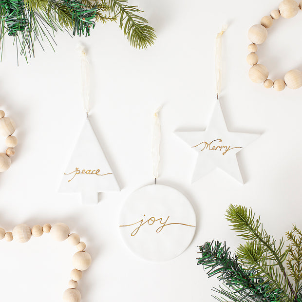 Set of three ceramic christmas tree ornaments, peace, merry, and joy painted words