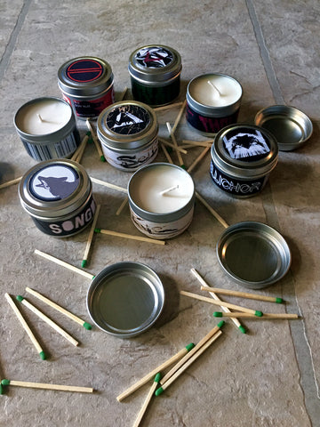 group of 2oz candles surrounded by a pile of matches
