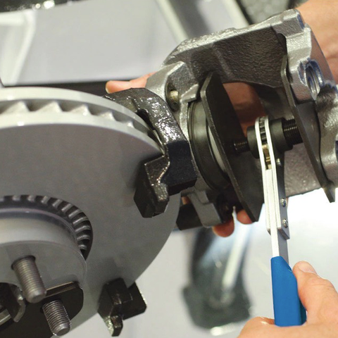 CaliKing™ - Caliper Tool Press being used on floating brake caliper