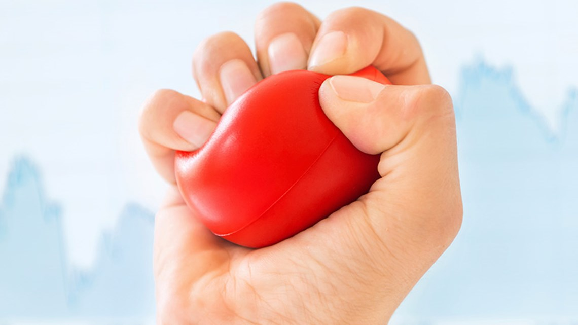 Person squeezing a soft stress ball