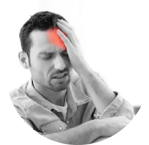 A man holding his head with a headache