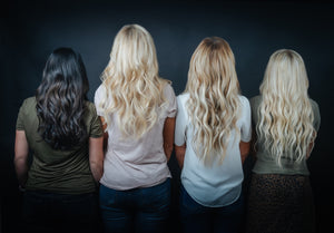Four women with hair extensions facing forward