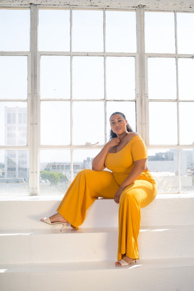 plus size model in mustard crop top wide leg pant set
