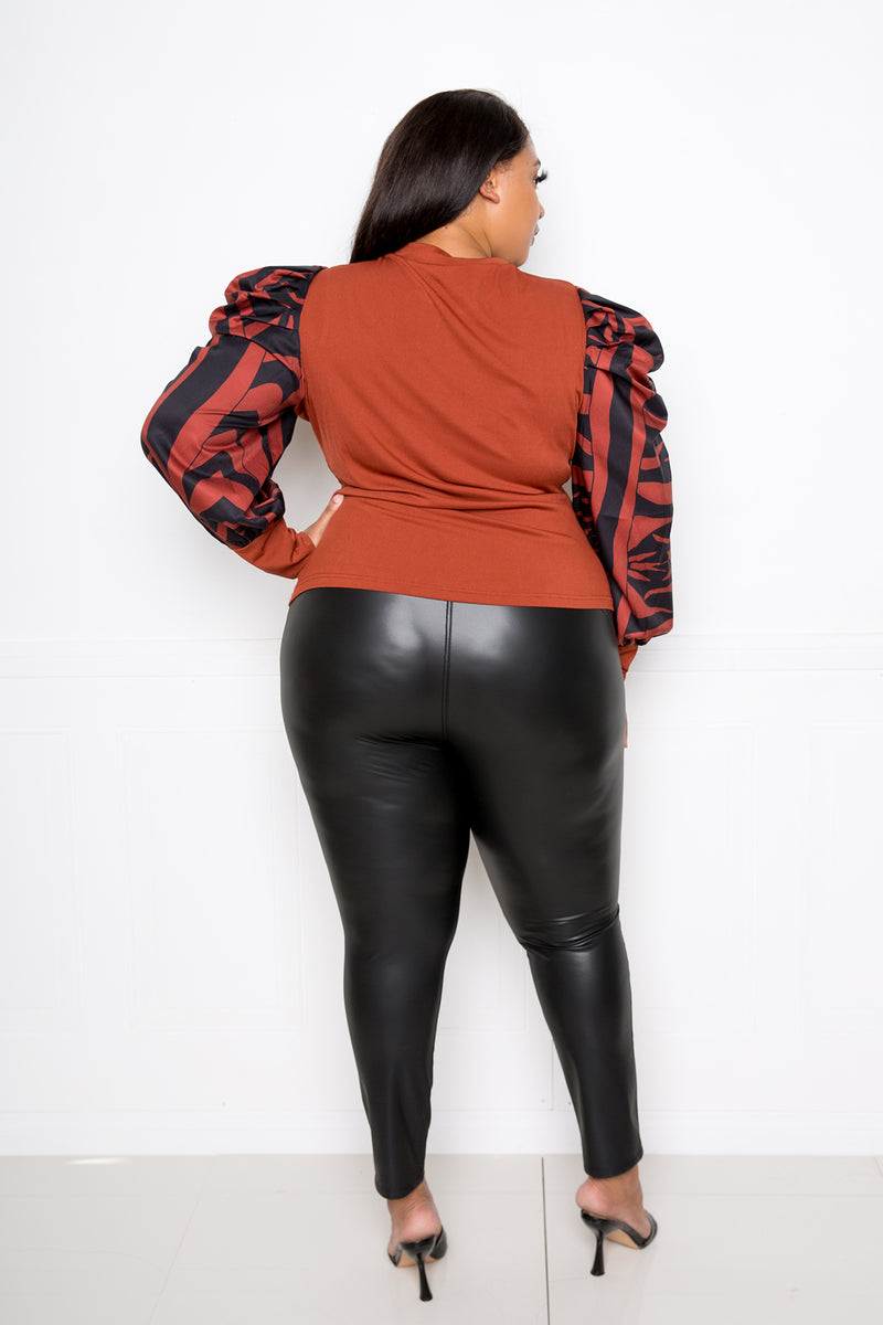 buxom couture curvy women plus size ribbed top with animal print sleeves rust brown orange zebra
